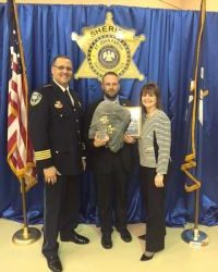 Natalie Tatje recognizes Bo Bessinger as Officer of the Year