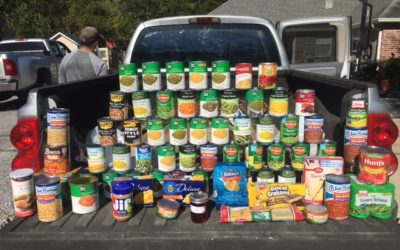 Tatje Insurance joins her fellow B2B members in donating can good to Ministry of Care for the needy.