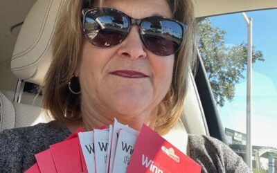 Tatje Insurance gives thanks by giving out Winn Dixie Cards.